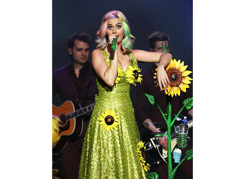 Singer Katy Perry posing in a sunflower dress