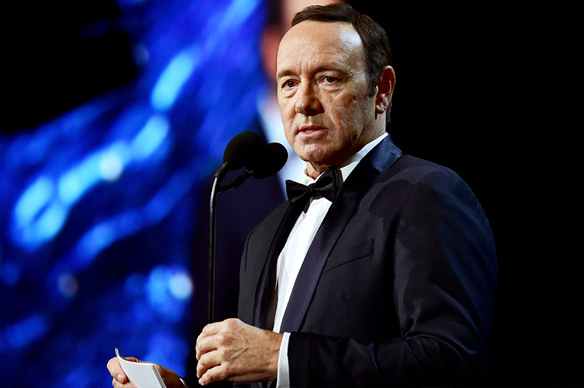 Actor Kevin Spacey on stage wearing a black tux and white dress shirt
