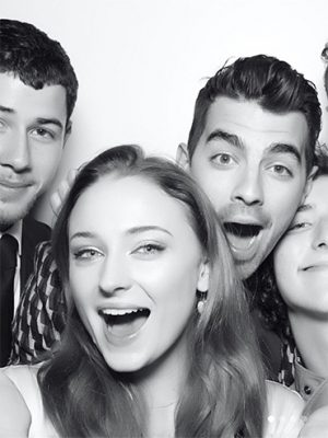 Sophie Turner and Joe Jonas Engaged: Sophie Turner and Joe Jonas Engaged: Sophie Turner and Joe Jonas are engaged and this pic was uploaded on Instgram from their engagement party and shows the couple with some of the Jonas brothers in a photo booth, greyscale