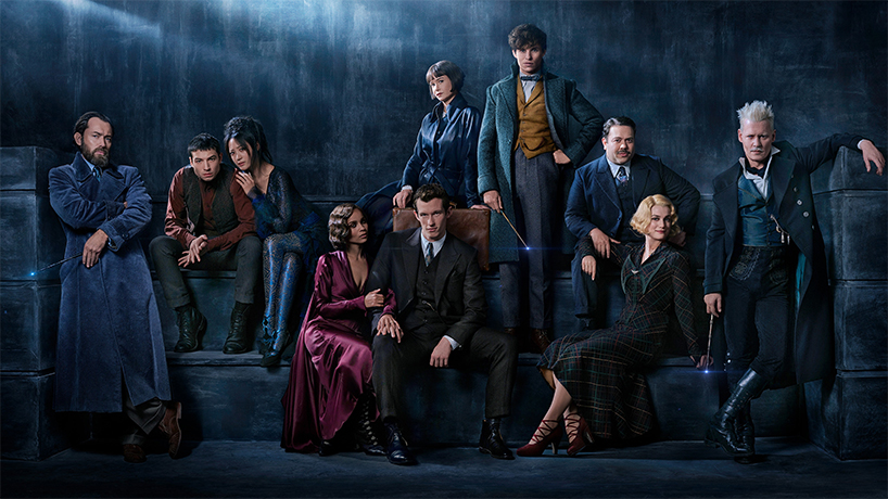 The Crimes of Grindelwald with the rest of the cast in a moody,c ark coloured cast photo