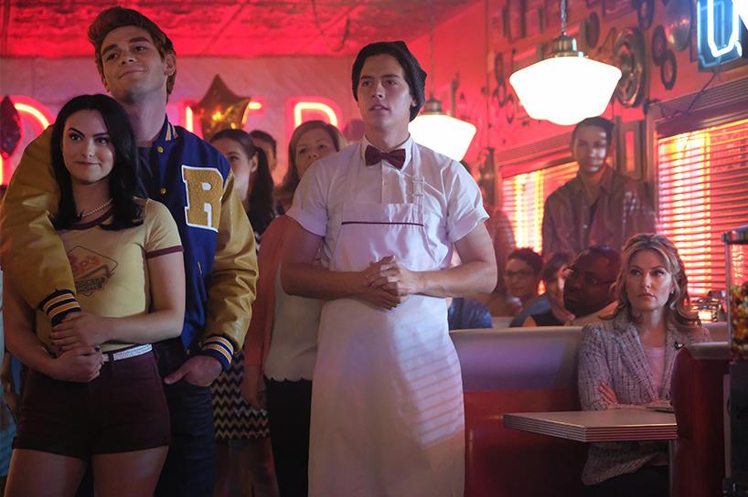 Cole Sprouse, KJ Apa and Cami Mendes pose in Pops diner on Riverdale