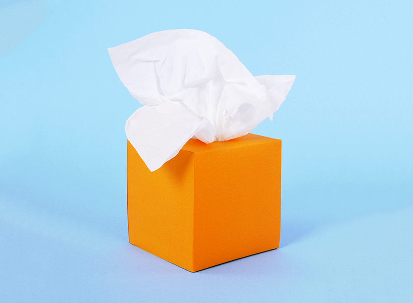 An orange tissue box against a blue background