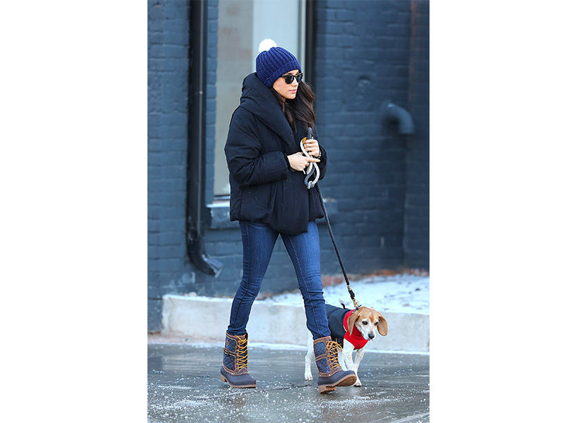 Meghan Markle wearing a winter coat, hat and boots by Canadian brand, Kamik, while walking her dog.