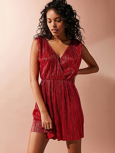Date night mini dresses: A model wears a red sparkly mini dress from Urban Outfitters