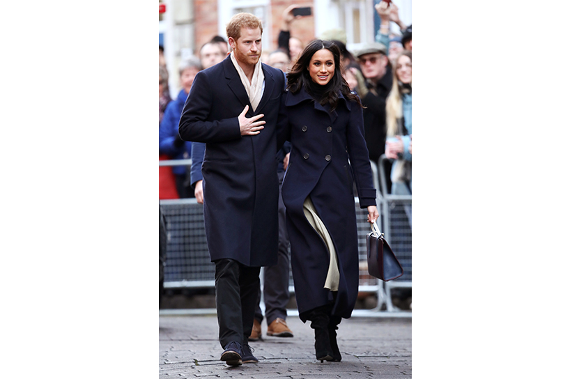 Meghan Markle and Prince Harry stroll arm in arm during their first public outing in Nottingham, England