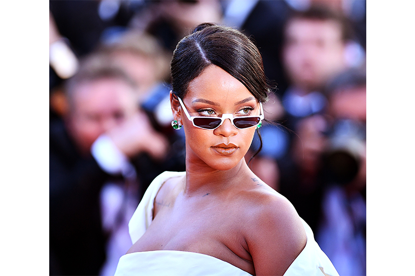 Rihanna posing for photos on the Cannes red carpet