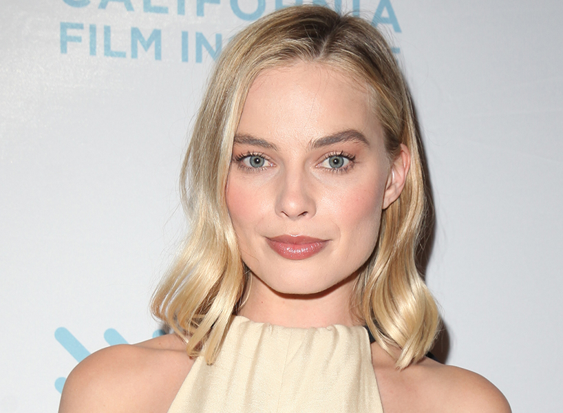 Margot Robbie on marriage: Margot Robbie poses for photos on the red carpet for a premiere of 'I, Tonya' at the Christopher B. Smith Rafael Film Center on December 2, 2017