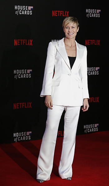 Robin Wright in a white pantsuit attends the World Premiere of 'House of Cards' Season 3