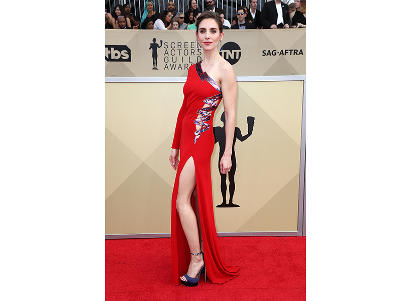 Alison Brie on the SAG Awards red carpet in a one-shoulder red dress