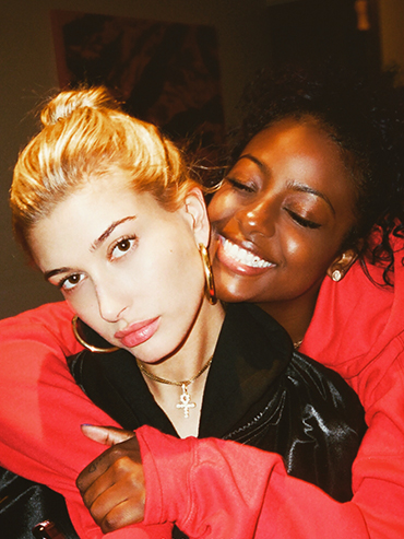 celeb best friends: justine skye hugging her bff hailey baldwin