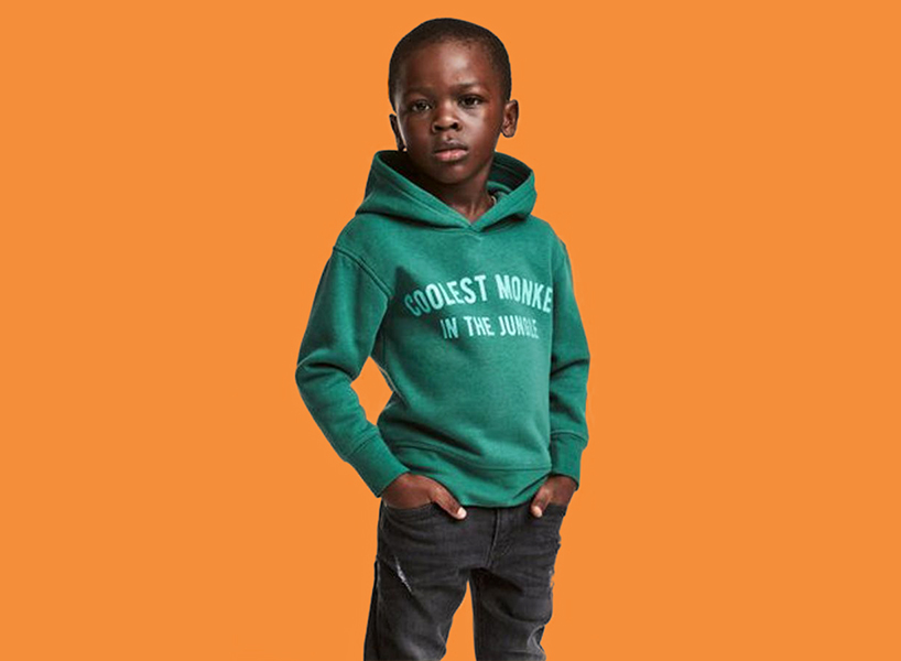 HM Racist Sweater A Photo Of Young Black Boy Wearing Green That