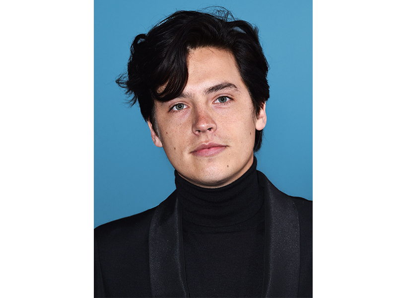 Cole Sprouse posing in a black turtleneck