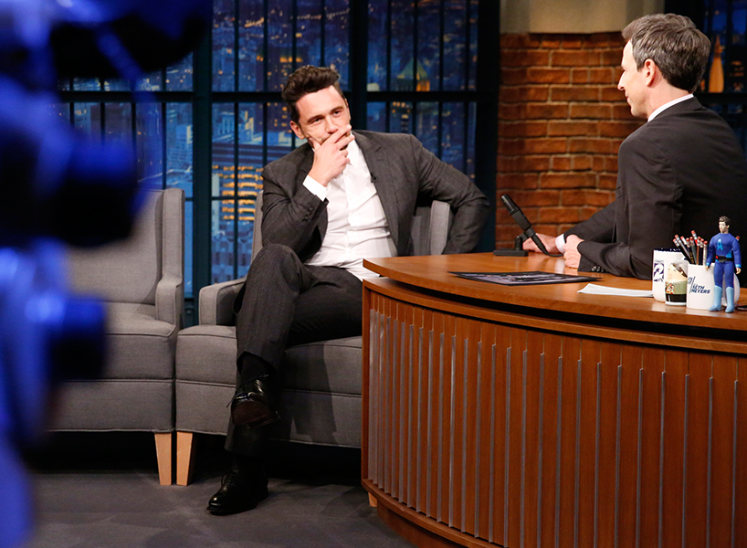 James Franco sitting in a chair talking to Seth Meyers