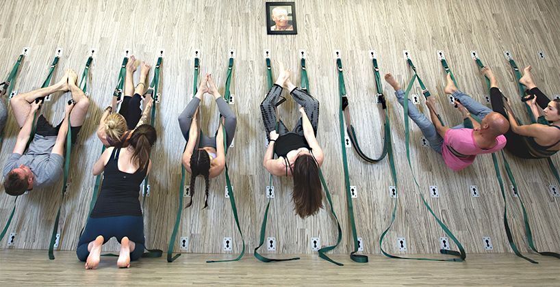 Yoga on the Wall at Yoga Public in Winnipeg is one of the best fitness classes in Canada
