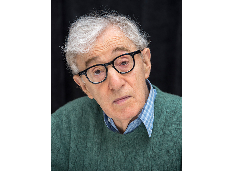 Woody Allen posing in glasses