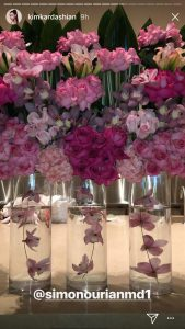Three vases hold purple and pink flowers that were given to Kim Kardashian.