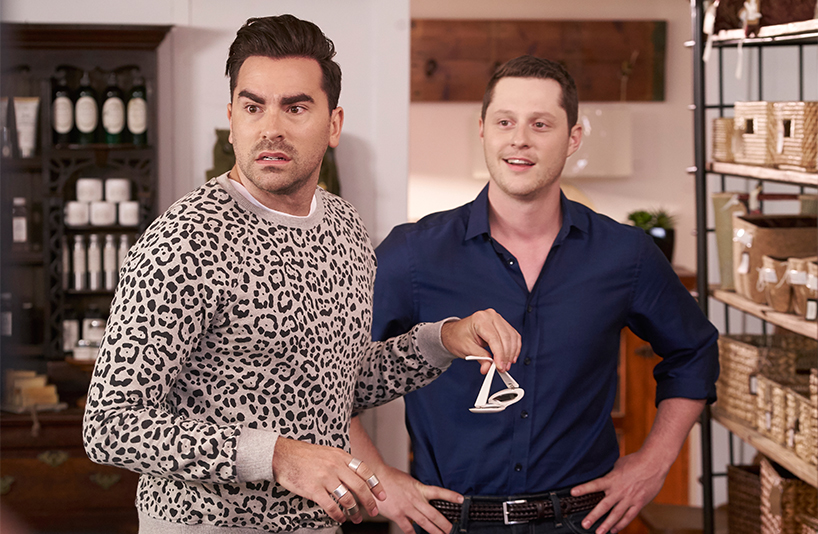Dan Levy and Noah Reid in David and Patrick's store, Rose Apothecary, in a scene from the fourth season of Schitt's Creek