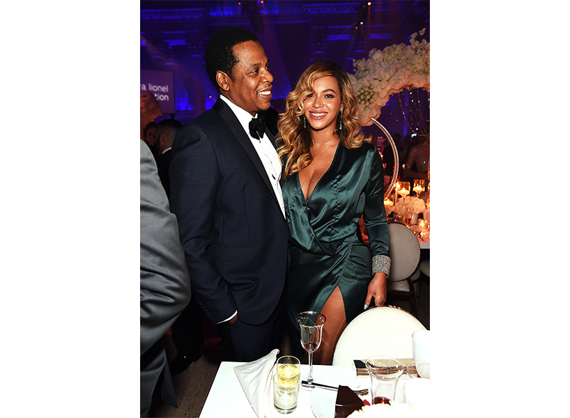 Beyonce wears an emerald green dress and attends Rihanna's annual Diamond Ball alongside Jay-Z, who wears a tux.