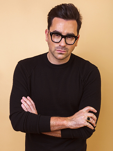 Schitt's Creek Dan Levy Boyfriend: Dan Levy wears a black sweater and black-rimmed glasses