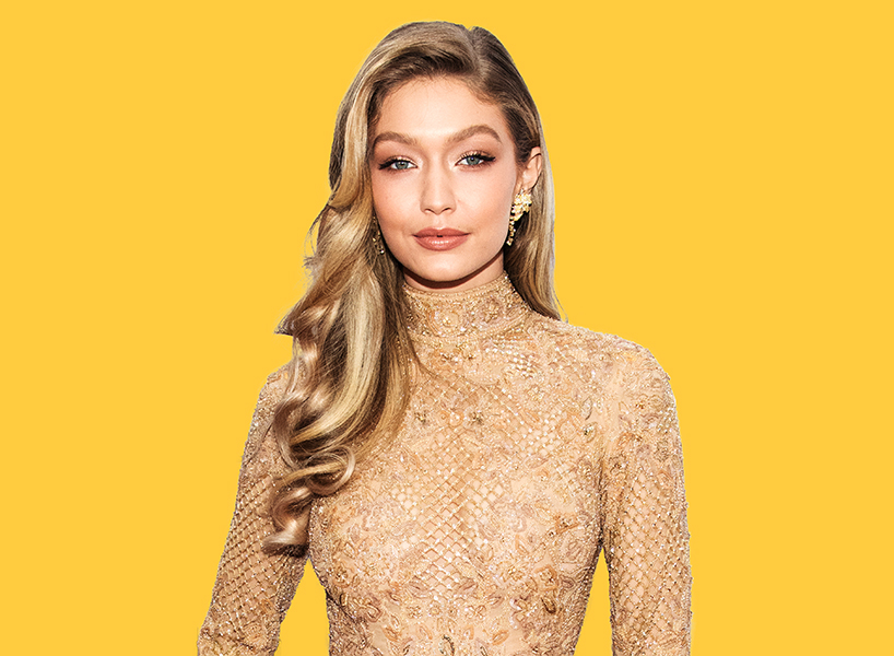 Gigi Hadid on weight loss: The model, pictured here in a gold dress, spoke out on Twitter