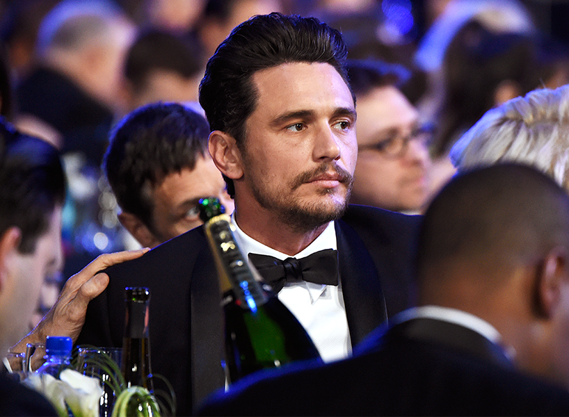 Actor James Franco sitting at a table