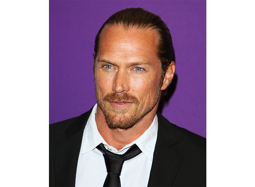 Actor Jason Lewis posing in a white shirt and black tie