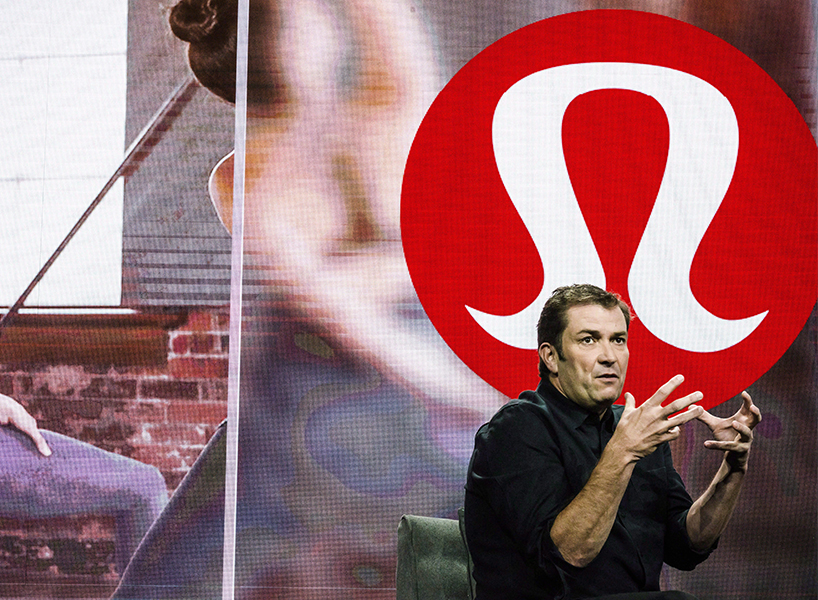 A photo of former Lululemon CEO Laurent Potdevin against the brand's logo