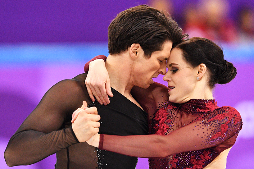 Tessa Virtue and Scott Moir embrace during their team skating performance at the Winter Olympics 2018