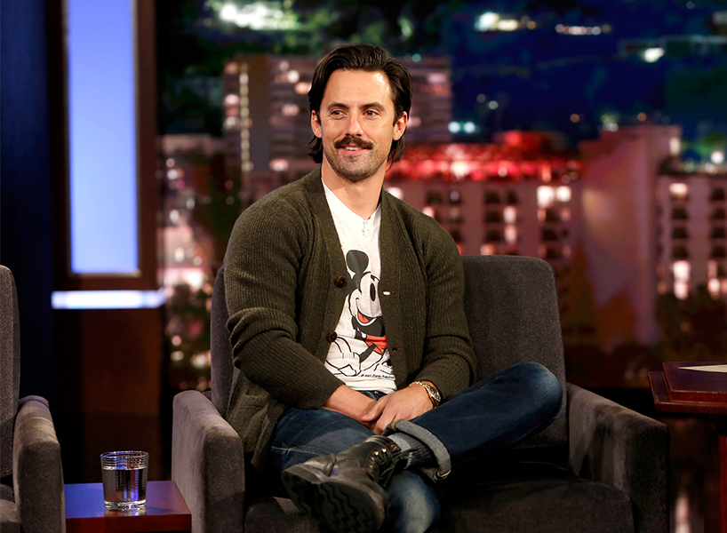 This is Us actor Milo Ventimiglia wears a mickey mouse shirt and a brown cardigan on the set for Jimmy Kimmel Live