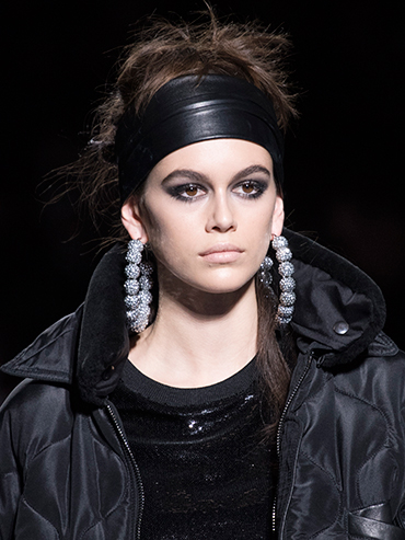 Kaia Gerber wears a black headband at Tom Ford NYFW FW 18