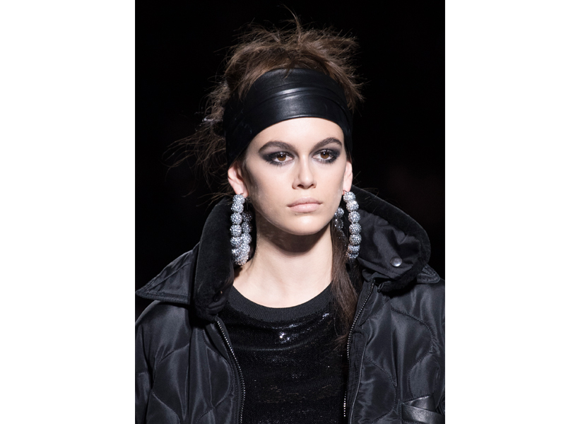 Kaia Gerber wears a thick black hairband at Tom Ford's NYFW runway show