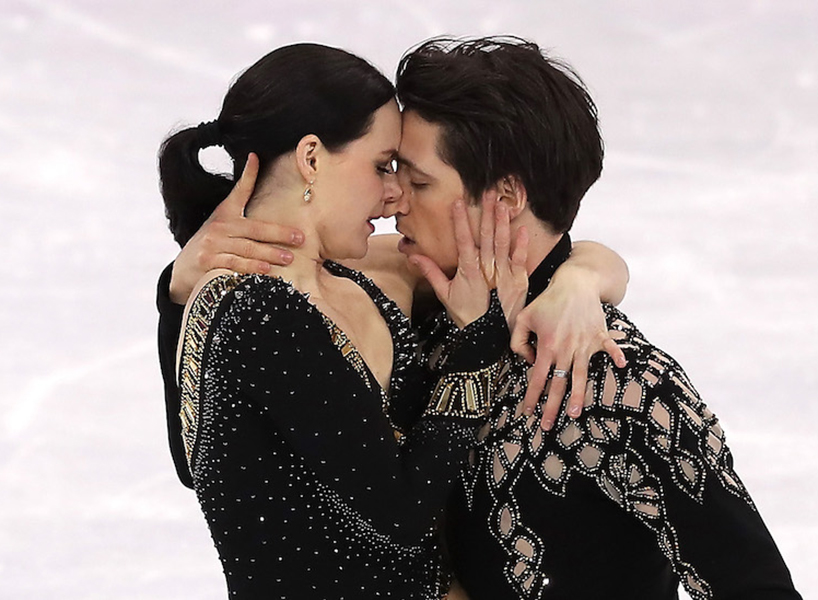 Tessa Virtue and Scott Moir embrace on the ice during their short dance performance.