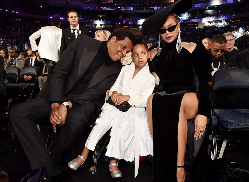 Blue Ivy art auction: Blue Ivy Carter sits between her parents Jay-Z and Beyonce Knowles-Carter at the 2018 GRAMMY Awards