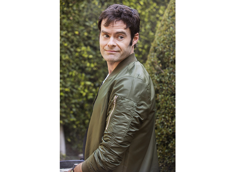 Bill Hader Hot: Bill Hader wears an olive green bomber jacket and looks over his shoulder with a slight grin