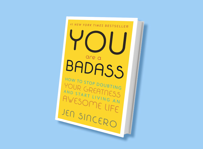 Self-Help Books: The cover of Jen Sincero's You Are A Badass against a bright blue background.