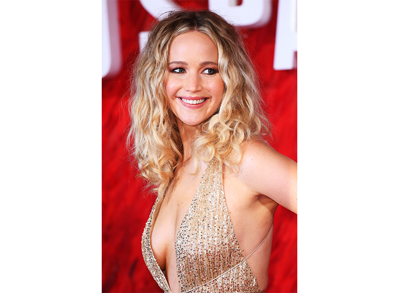 Jennifer Lawrence in a dress smiling