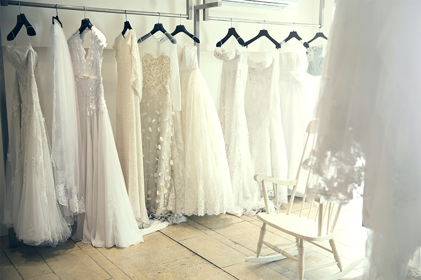 A row of wedding gowns