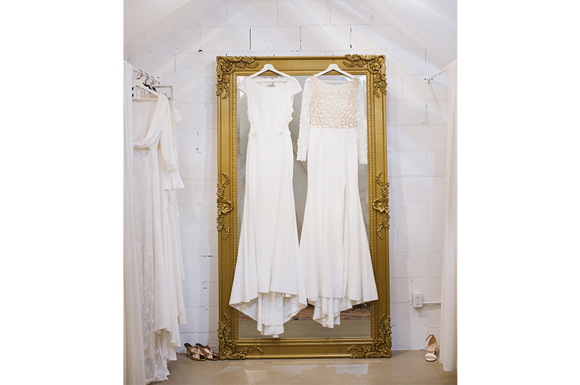 Two bridal dresses hanging