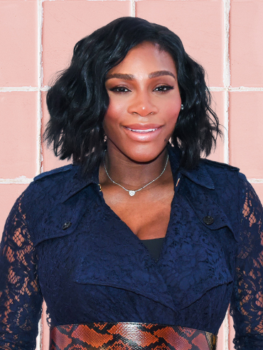 Serena Williams makeup: Tennis pro Serena Williams in a navy blue outfit on a background of blush pink makeup