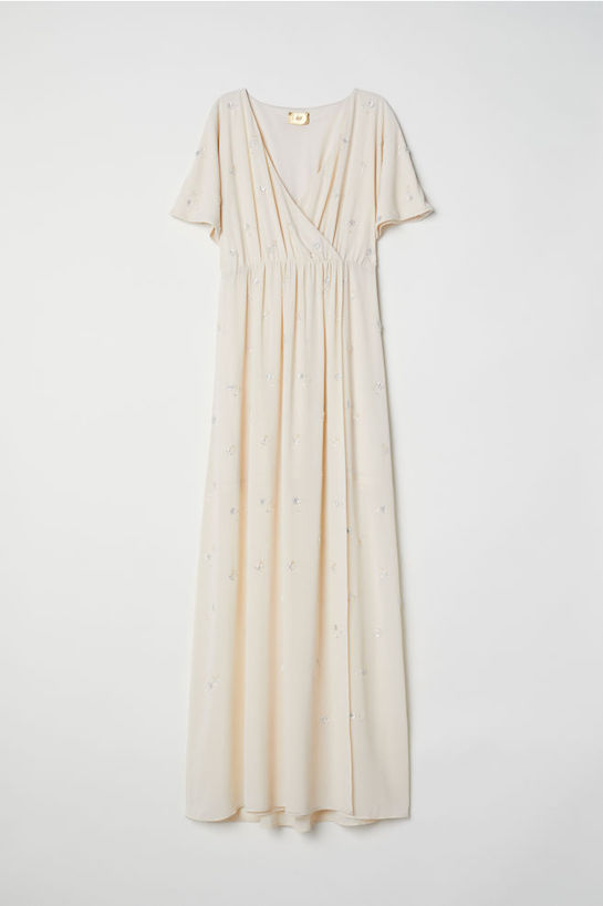 "<p>Wrap Dress with Embroidery, $150, <a href=""http://www2.hm.com/en_ca/productpage.0619209001.html"" target=""_blank"" rel=""noopener"">hm.com</a></p>"
