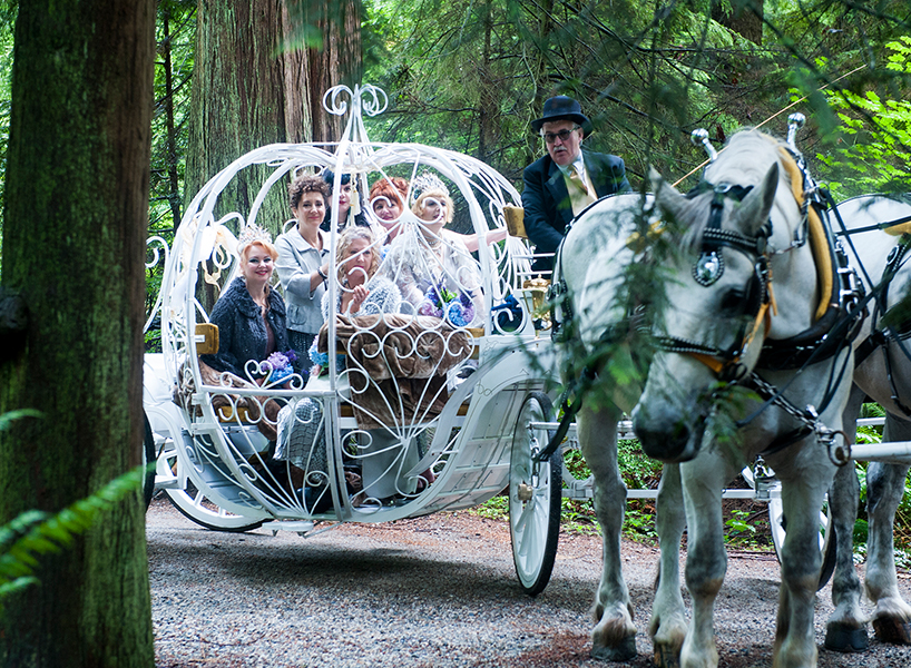 Brides being pulled in a carriage