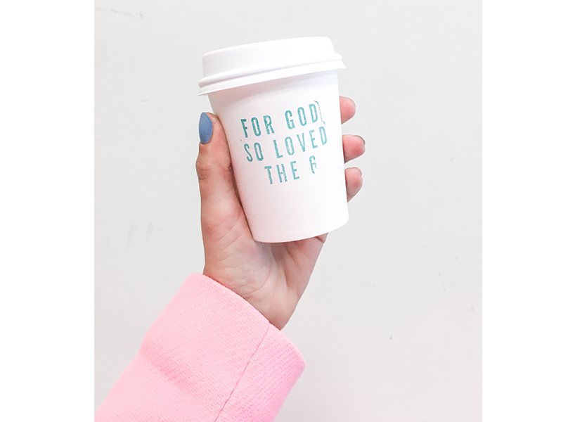 """A white coffee cup stamped with the saying """"For God So Loved the 6"""""""