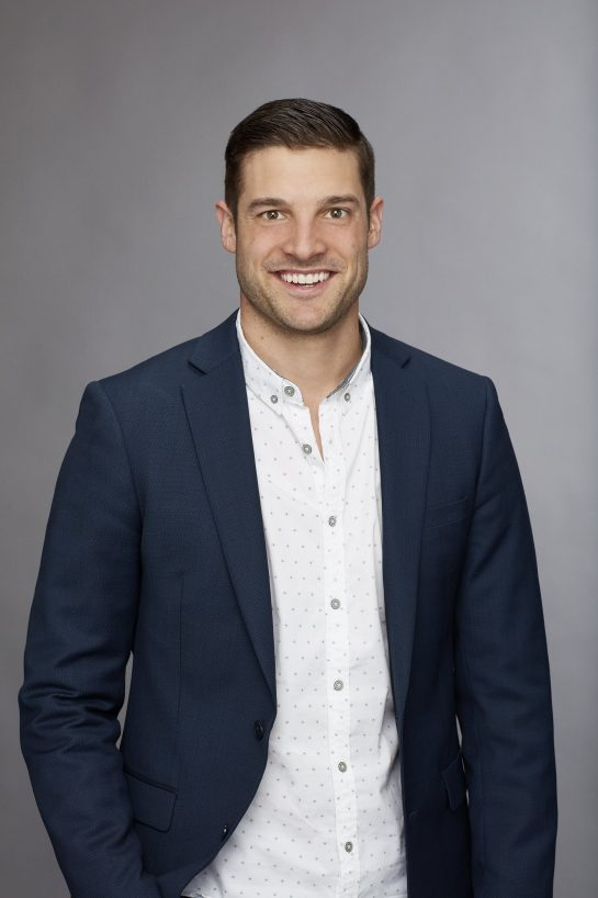 A photo of Bachelorette season 14 contestant Garrett in a white shirt and dark blazer