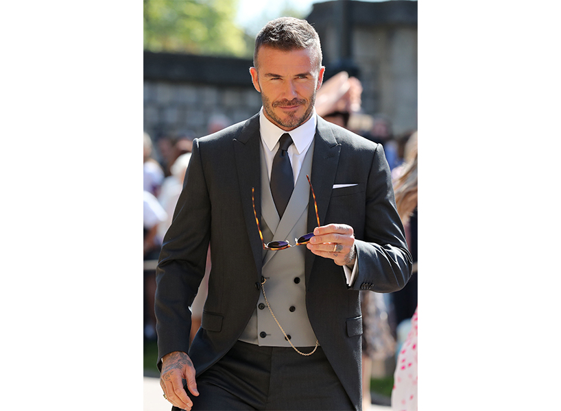 How guys royal wedding: David Beckham in a black suit and grey vest at Meghan and Harry's wedding.