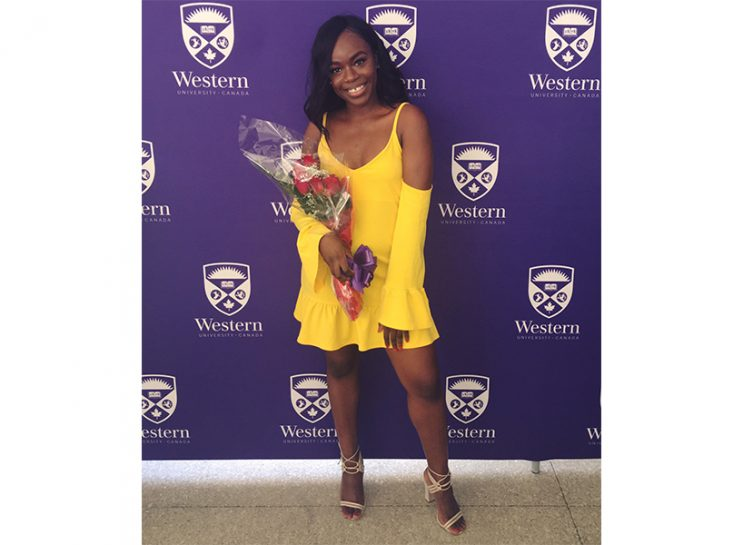 Surviving Sexual Assault: Writer Joelle Kabisoso, who is a survivor of sexual assault, in a yellow dress at a Western University event