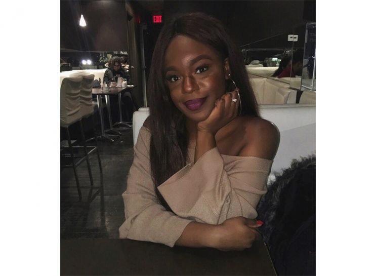 Surviving Sexual Assault: Writer Joelle Kabisoso, who is a survivor of sexual assault, sitting at a table in a restaurant