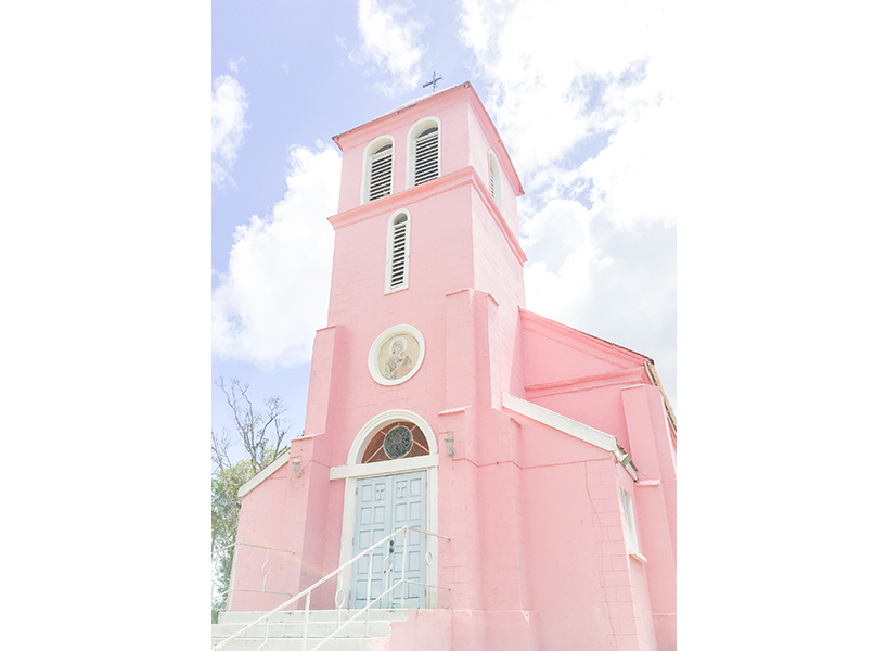 Adult believers baptism-a photo of a pink stucco church with a steeple-inline