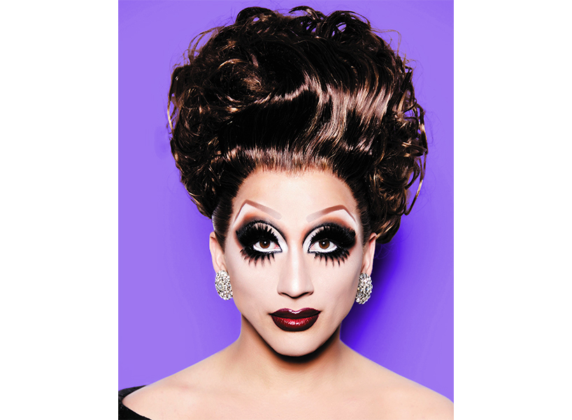 Bianca Del Rio looks directly into camera, wearing full face of makeup