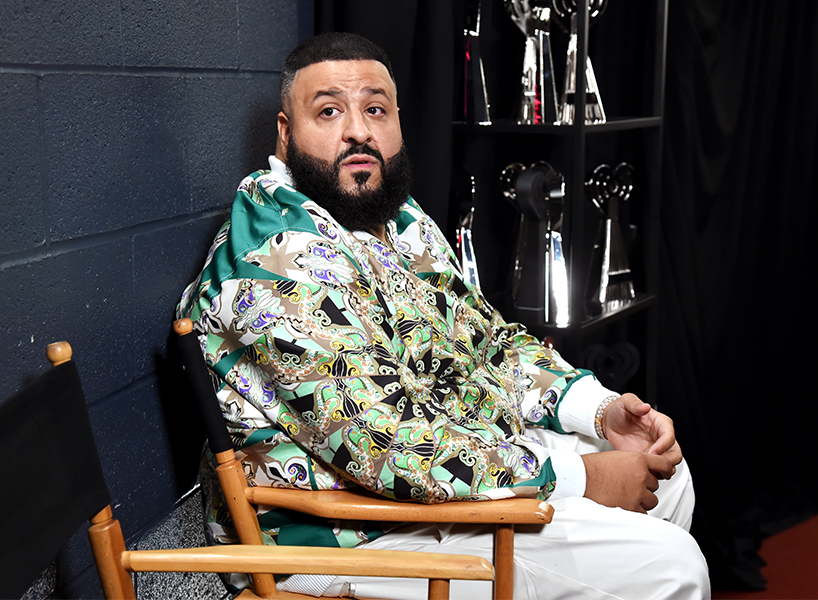 Producer DJ Khaled sitting in a chair