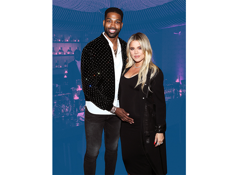 NBA player Tristan Thompson standing next to girlfriend Khloe Kardashian